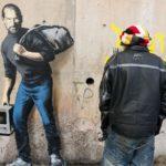 Steve Jobs auf Mauer in Flüchtlingsanlage in Calais